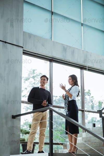 business people chatting in balcony