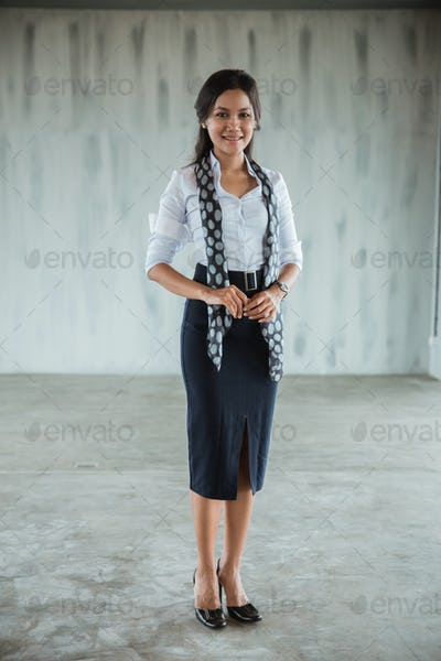 asian woman worker standing smile with scarf