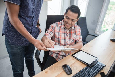 employee asking for signature of his partner