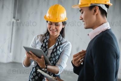 supervisor woman engineer look a property concept design on tablet digital