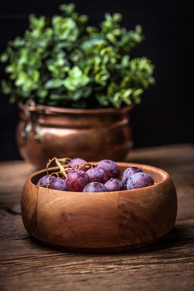 Grapes in a wooden bowl.