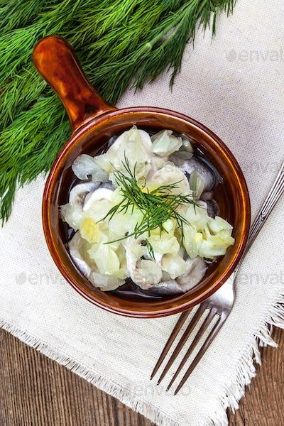 Tasty herring in pieces.