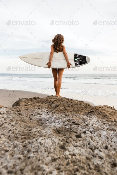 Surfing time for sporty lady.