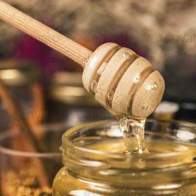 Wooden Dipper with Flowing Honey