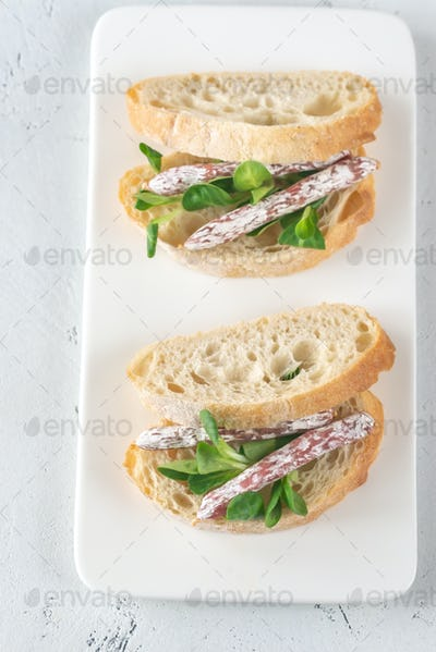Sandwich with mini fuets on the white background