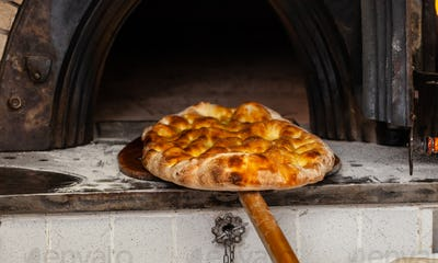 Schiacciata is a kind of bread made in Tuscany, Italy.