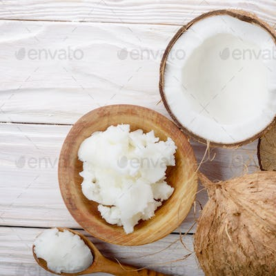 Flat lay background of coconut shell hard oil in wooden bowl on