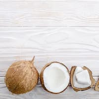 Flat lay background of coconut, coconut shell and meat pieces on