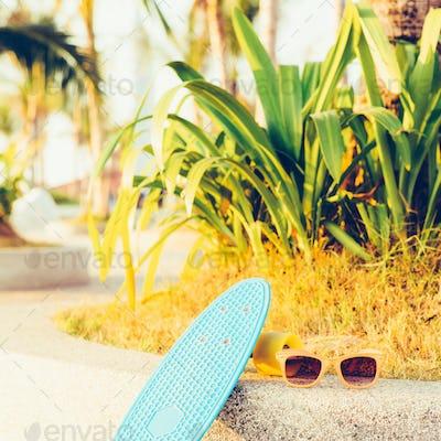light blue longboard penny board with multicolored wheels ready