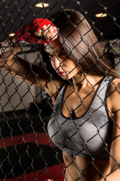 Beautiful female workout functional training.
