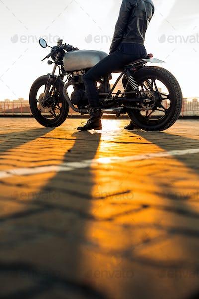 Biker girl on caferacer motorcycle.