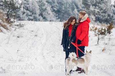 Beautiful couple playing with a dog