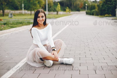 Cute and pretty girl in a summer park