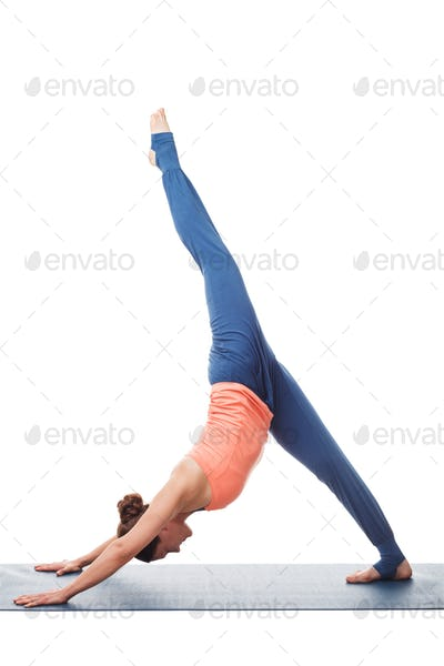 Sporty fit yogini woman practices yoga asana eka pada adhomukha