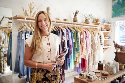 Portrait Of Female Owner Of Clothing And Gift Store