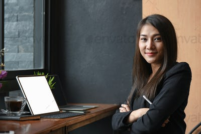 New young asian female executives are working in office.She is proud.