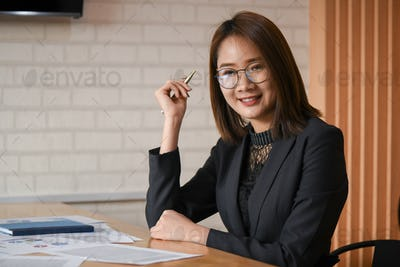 New asian female executives are working in the office.