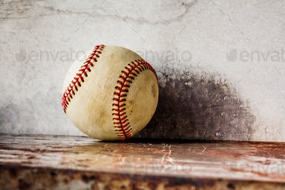 Old baseball on shabby metal textured background. Macro view ball, shallow depth of field, copy