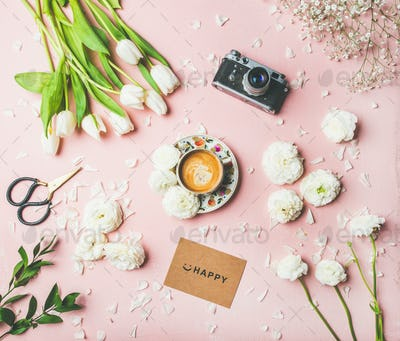 Spring layout with coffee, flowers, sign with lettering happy