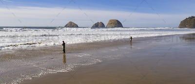 Fishermen Wade in Ocean Surf Hoping to Catch Fish