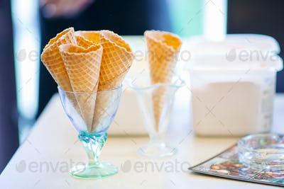 Empty waffle cone in glass for ice cream