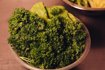 Plate with tasty and fresh green leaf of salad