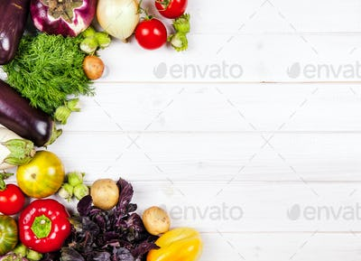 fresh vegetables on white wooden background