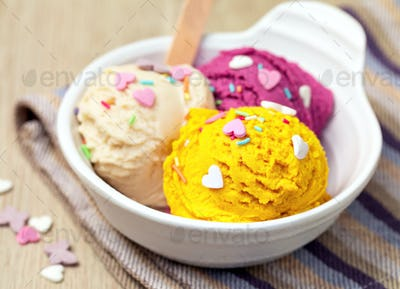 Bowl with tasty ice cream on table