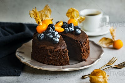 Chocolate cake with fresh Blueberry and Cape Gooseberry