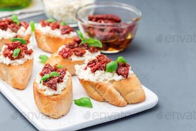 Bruschetta with sun dried tomato, feta and philadelphia cheese a