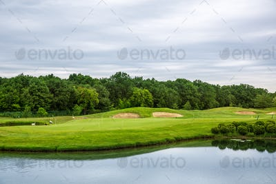 Mirror lake, lawn for golfing on golf course