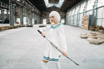 Anime style blonde girl with sword