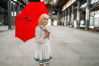 Pretty anime style blonde girl with red umbrella