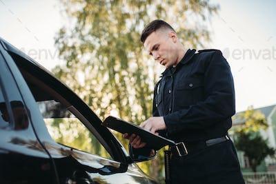 Policeman in uniform writes fine to female driver