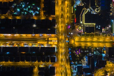 Aerial Night Vertical View Of City Street Traffic Buildings