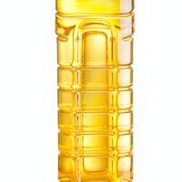 Vegetable or sunflower oil in plastic bottle isolated on white b
