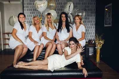 Beautiful and positive bide mades having fun on hen party