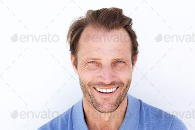 Close up happy older man smiling against white background