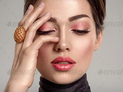 Beautiful young fashion woman with living coral lipstick. Attrac