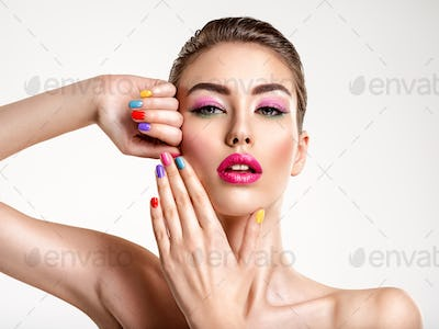 Beautiful fashion woman with a colored nails. Attractive white g