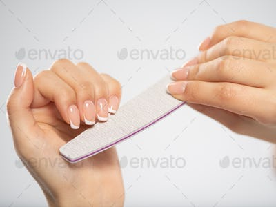 Woman gets manicure procedure in a spa salon. Beautiful female h