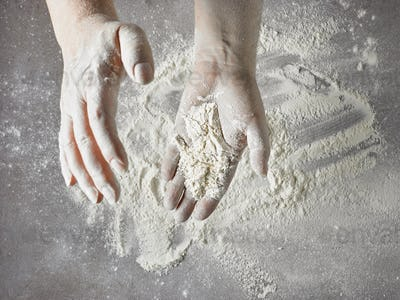 baker hands with flour in motion