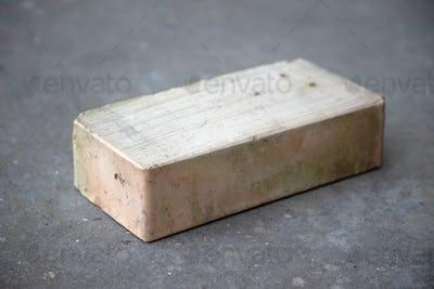 old brick on grey concrete background
