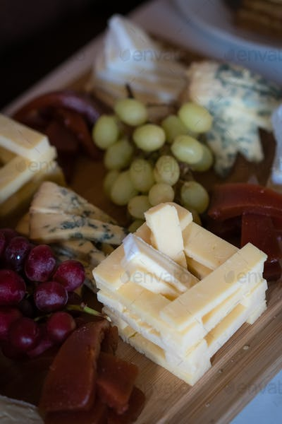 Cheese platter on a wooden desk