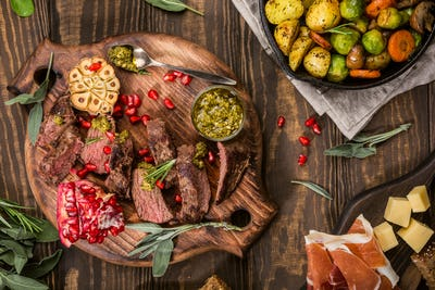 Meat steak with green pesto