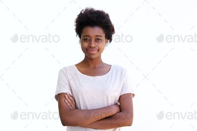 Young african woman standing with arms crossed against white background
