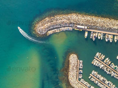 Marina top down aerial view boat sailing off