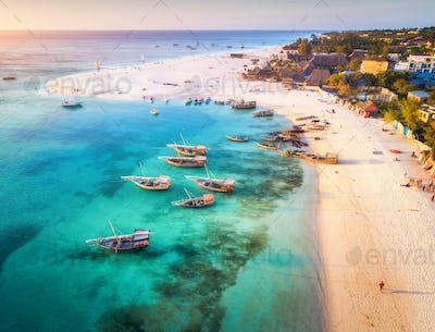 Aerial view of fishing boats on tropical sea coast in summer