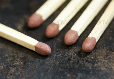 Matches on a rusty metal background