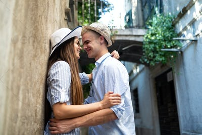 Romantic happy tourist couple hugging on summer vacation